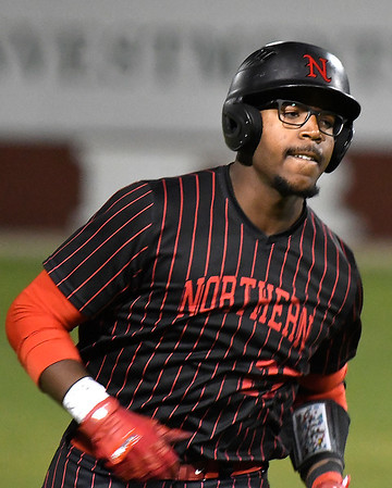 NOC Enid's E.J. Taylor bites his lip as he jogs the bases after hitting his second home run against Pasco-Hernando in the semi-finals of the NJCAA DII World Series Thursday, May 30, 2019, at David Allen Memorial Ballpark. (Billy Hefton / Enid News & Eagle)