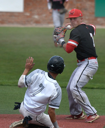 Northeast CC's Drew Smith throws over Madison's Carl Valk during the NJCAA DII World Series Monday May 27, 2019 at David Allen Memorial Ballpark. (Billy Hefton / Enid News & Eagle)