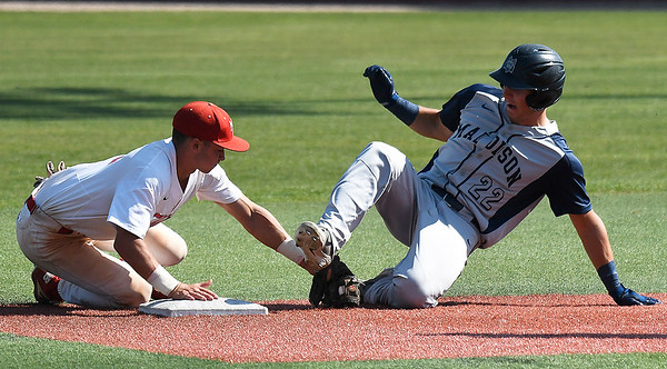 Mesa's Josh Leslie tags out Madison's Nick Gile during the semi-finals of the NJCAA DII World Series Thursday, May 30, 2019, at David Allen Memorial Ballpark. (Billy Hefton / Enid News & Eagle)