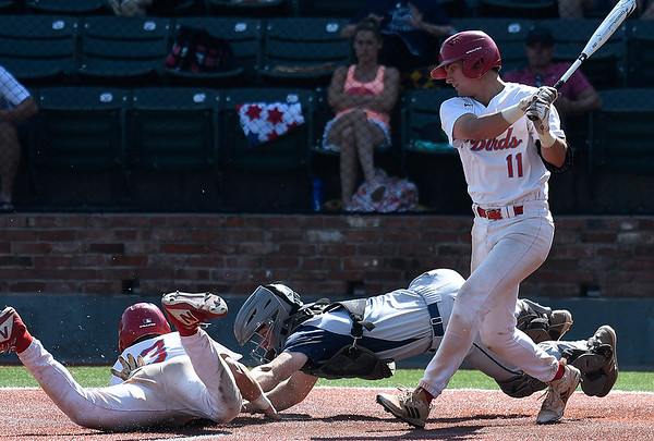 Madison's Lucas Trebian tags out Mesa's Josh Leslie trying to steal home during the semi-finals of the NJCAA DII World Series Thursday, May 30, 2019, at David Allen Memorial Ballpark. (Billy Hefton / Enid News & Eagle)