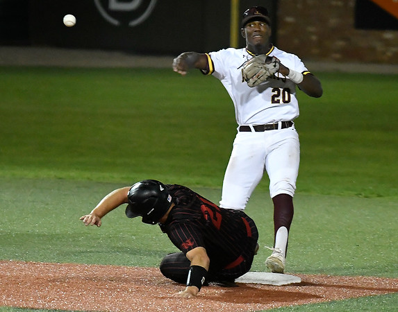 Pearl River's Dexter Jordan throws to first over NOC Enid's Tanner Neely during the NJCAA DII World Series Monday May 27, 2019 at David Allen Memorial Ballpark. (Billy Hefton / Enid News & Eagle)