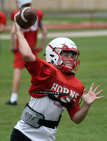 Chisholm's Kaleb Dent throws a pass during spring practice Wednesday May 22, 2019. (Billy Hefton / Enid News & Eagle)