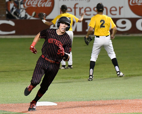 NOC Enid's Shane Nixon heads for third with a triple against Pasco-Hernando in the semi-finals of the NJCAA DII World Series Thursday, May 30, 2019, at David Allen Memorial Ballpark. (Billy Hefton / Enid News & Eagle)