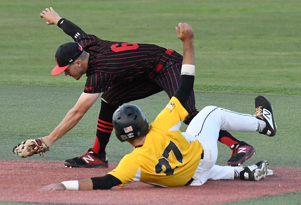 NOC Enid's Clay Lockett gets a force out on Pasco-Hernando's Connor Berry in the semi-finals of the NJCAA DII World Series Thursday, May 30, 2019, at David Allen Memorial Ballpark. (Billy Hefton / Enid News & Eagle)