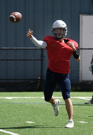 Enid's Maddux Mayberry throws a pass during spring practice Tuesday May 21, 2019 at D. Bruce Selby Stadium. (Billy Hefton / Enid News & Eagle)