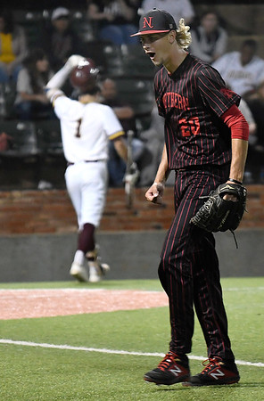 NOC Enid's Brandon Hudson lets out a yell as he comes off the field after striking out a batter against Pearl River during the NJCAA DII World Series at David Allen Memorial Ballpark. (Billy Hefton / Enid News & Eagle)