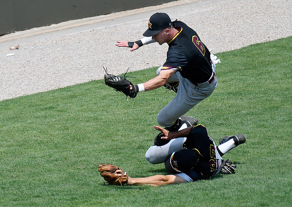 Pearl River's Matt Taylor falls over Wiley Cleand after making a catch in shallow leftfield against Pasco-Hernando during the NJCAA DII World Series Tuesday May 28, 2019 at David Allen Memorial Ballpark. (Billy Hefton / Enid News & Eagle)