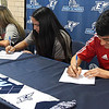 (left to right) Nadia Chavez, Janet Moreno and Ivan Delgadillo sign letters of intent to play soccer for NOC Tonkawa during a ceremony at Enid High School Thursday May 16, 2019. (Billy Hefton / Enid News & Eagle)