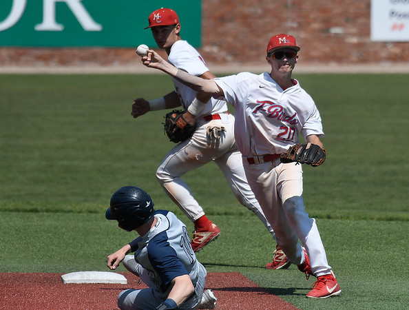 Mesa's Taylor Darden throws over Madison's Walker Jenkins for a doubleplay during the semi-finals of the NJCAA DII World Series Thursday, May 30, 2019, at David Allen Memorial Ballpark. (Billy Hefton / Enid News & Eagle)
