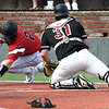 NOC Enid's Garrett Misenheimer dives around Redlands CC's Sam Matchus to score during the Region 2 championship Sunday May 12, 2019. (Billy Hefton / Enid News & Eagle)