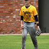 The uniform of Monroe CC's Logan Martelia-Tasick shows the effect the rainfall has had on the outfield during the NJCAA DII World Series. (Billy Hefton / Enid News & Eagle)