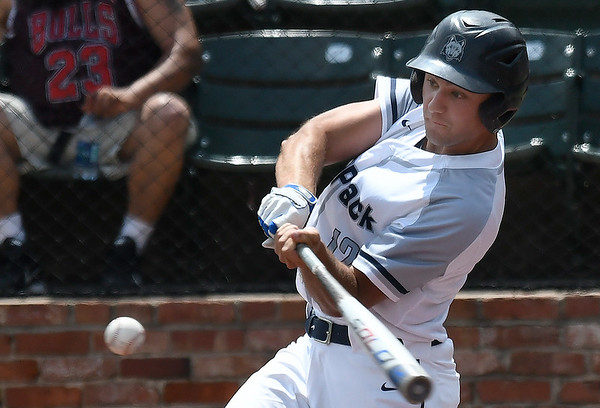 Madison College's Carson Holin hits a single against Northeast CC during the NJCAA DII World Series Monday May 27, 2019 at David Allen Memorial Ballpark. (Billy Hefton / Enid News & Eagle)