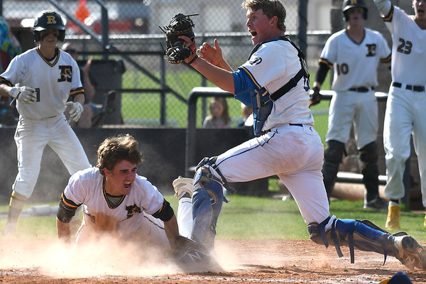 Drummond's Wyatt Gray and Roff's Wil Joplin both let out a yeall after a plate at home plate during the Class B state championship game Saturday May 4, 2019 at Shawnee High School. Joplin was called safe on the play. (Billy Hefton / Enid News & Eagle)