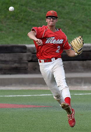 Mesa's Luke Patty makes an off balance throw to first against Lincoln Land Sunday May 26, 2019 during the NJCAA DII World Series. (Billy Hefton / Enid News & Eagle)