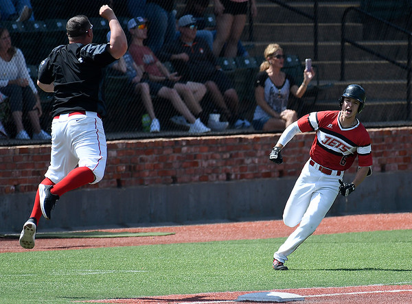NOC Enid assistant coach, Nolan Fanning, leaps in the air as Clay Lockett rounds the bases after hitting a walk off grand slam home run against Redlands CC Sunday May 12, 2019 during the Region 2 tournament at David Allen Memorial Ballpark. (Billy Hefton / Enid News & Eagle)