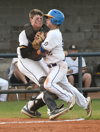 Drummond's Bryce Longpine collides with Roff's Connor Owens  during the Class B state championship game Saturday May 4, 2019 at Shawnee High School. (Billy Hefton / Enid News & Eagle)
