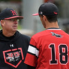 NOC Enid head coach, Raydon Leaton, visits the mound to talk to Kaleb McCullough during the Region 2 tournament against Murray State Thursday May 9, 2019 at David Allen Memorial Ballpark. (Billy Hefton / Enid News & Eagle)