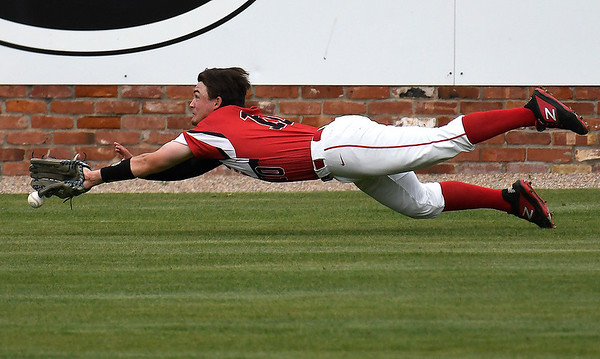 NOC Enid's Brendon Woelfle makes a diving attempt for a ball against Pasco-Hernando State during the NJCAA DII World Series Wednesday, May 29, 2019, at David Allen Memorial Ballpark. (Billy Hefton / Enid News & Eagle)