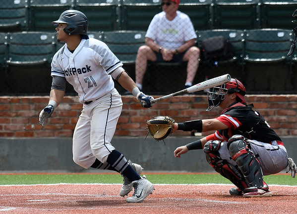 Madison College's Marquis Reuter hits a single against Northeast CC during the NJCAA DII World Series Monday May 27, 2019 at David Allen Memorial Ballpark. (Billy Hefton / Enid News & Eagle)