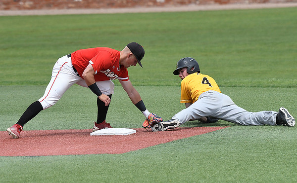 Monroe CC's Cas Sobaszek is tagged out by Northeast's Drew Smith after sliding pass second base Sunday May 26, 2019 during the NJCAA DII World Series. (Billy Hefton / Enid News & Eagle)