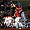 NOC Enid players celebrate winning the Region 2 championship Sunday May 12, 2019. (Billy Hefton / Enid News & Eagle)