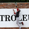 NOC Enid's Brendon Woelfle leaps against the wall to make a catch against Carl Albert CC during the Region 2 tournament Friday May 10, 2019 at David Allen Memorial Ballpark. (Billy Hefton / Enid News & Eagle)