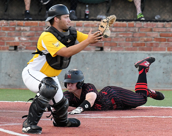 NOC Enid's Brendon Woelfle slides into home behind Pasco-Hernando's Nick Alessi during the semi-finals of the NJCAA DII World Series Thursday, May 30, 2019, at David Allen Memorial Ballpark. (Billy Hefton / Enid News & Eagle)