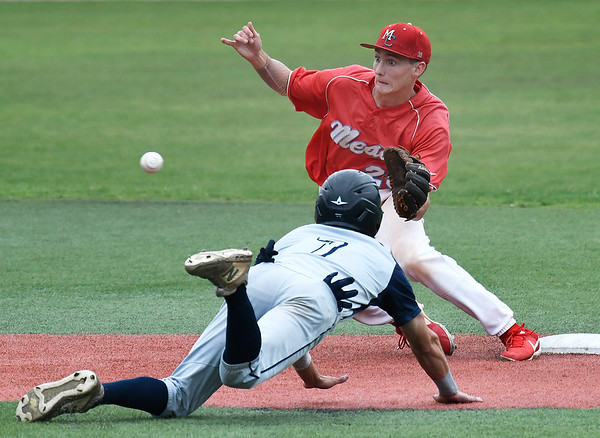 Mesa's Taylor Darden waits on the ball as Madison's Carl Valk dives into second base Tuesday May 28, 2019 during the NJCAA DII World Series at David Allen Memorial Ballpark. (Billy Hefton / Enid News & Eagle)