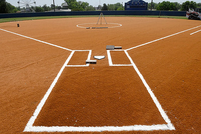 Artificial turf being installed on the infield at Pacer Field at Meadowlake Park Monday, May 4, 2020. (Billy Hefton / Enid News & Eagle)