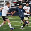 Enid's Luis Mendoza knocks the ball forward away from UNion's Shaun Riggins and Edwin Macario during the first round of the state playoffs Tuesday, May 4, 2021 D. Bruce Selby Stadium. (Billy Hefton / Enid News & Eagle)