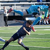 Union's Cameron McColloch leaps over Enid's Geovany Lupercio while knocking the ball away during the first round of the state playoffs Tuesday, May 4, 2021 D. Bruce Selby Stadium. (Billy Hefton / Enid News & Eagle)