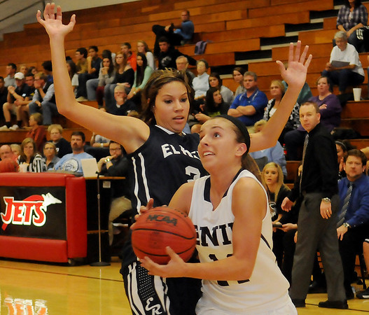 Enid's Abby Lee drives the baseline against an El Reno Lady Indian Thursday during the Pacers' home opener at the NOC-Enid Mabee Center. (Staff Photo by BONNIE VCULEK)