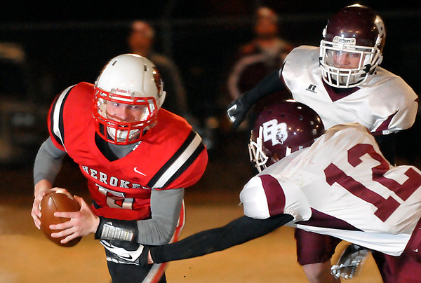 Cherokee's Tanner Bowman tries to avoid Balko's Justin Mays and Wyatt Casper Friday during the class C quarterfinal playoff game at Cherokee High School. (Staff Photo by BILLY HEFTON)