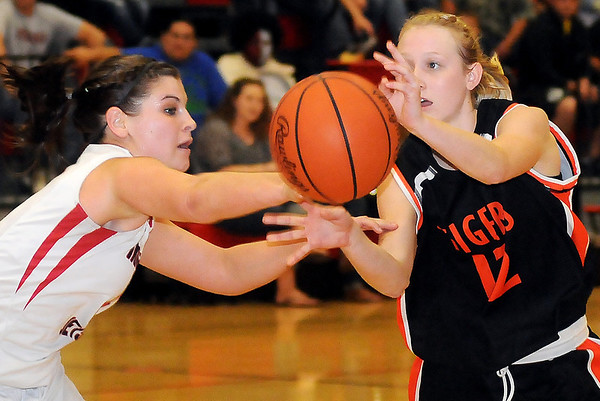 NOC Enid Lady Jets' Regan Crowl (left) knocks the ball out of the grasp of Cowley County Lady Tiger's Devery Alexander for a turnover Thursday at the Mabee Center. The Lady Tigers' defeated the Lady Jets 58-50. (Staff Photo by BONNIE VCULEK)