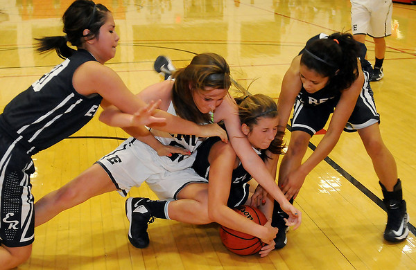 El Reno Lady Indians scramble for the ball after they block a shot by Enid's Andi Pierce (20) Thursday during the Pacers' 50-45 win at the Northern Oklahoma College-Enid Mabee Center. (Photo Courtesy of Enid News and Eagle, Bonnie Vculek)