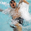 Enid's Gabe sanchez swims the backstroke in the 200 yard IM Monday at the Denny Price Family YMCA. (Staff Photo by BILLY HEFTON)