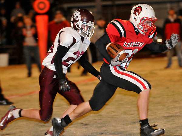 Cherokee's Josh Argraves out runs Balko's Wyatt Casper to the endzone for a 21-yard touchdown Friday during the class C quarterfinal playoff game at Cherokee High School. (Staff Photo by BILLY HEFTON)