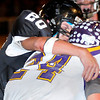 Pond Creek-Hunter's Devan McKee brings down Laverne quarterback, Tucker Rolf, Friday. (Staff Photo by BILLY HEFTON)