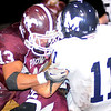 Pioneer's Aaron Chain and Jett Jobe tackle Minco's Jacob Overton Friday at Mustang Field. (Staff Photo by BONNIE VCULEK)