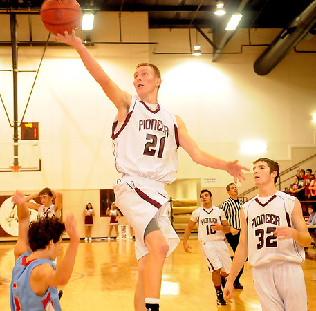 Pioneer's Blake Gabriel drives the lane for an easy lay up Friday against the Chisholm Longhorns at Pioneer High School. (Staff Photo by BONNIE VCULEK)