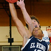 El Reno's Justin Brown snags an offensive rebound from Enid's Michael Majors Thursday during the Indians 56-49 win over the Enid Plainsmen at Northern Oklahoma College-Enid's Mabee Center. (Photo Courtesy of Enid News and Eagle, Bonnie Vculek)