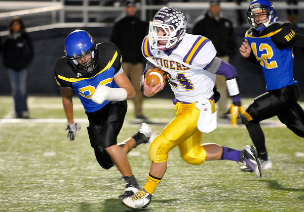 Laverne's Tucker Rolf breaks away for a 43 yard touchdown run against Rejoice Christian Friday during the Class B state semi-finals at Enid High School. (Staff Photo by BILLY HEFTON)