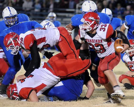 A Washington Warrior running back carries the ball for a first down against the Hennessey Eagles Friday during the 2A second round playoffs at Hennessey High School. The Eagles led 42-14 at the half. (Staff Photo by BONNIE VCULEK)