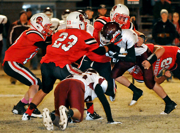 Cherokee defenders gang up to stop Balko quarterback, Clay Casper, Friday during the class C quarterfinal playoff game at Cherokee High School. (Staff Photo by BILLY HEFTON)