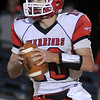 Washington's Brock Harmon looks for an open receiver Friday during the Warriors 2A second round playoff game against the Hennessey Eagles at Hennessey High School. (Photo by BONNIE VCULEK, Enid News and Eagle)