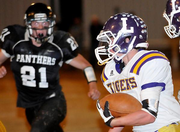 Laverne's Trevor Harris turns the corner for 53 yard touchdown run Friday against Pond Creek-Hunter. (Staff Photo by BILLY HEFTON)