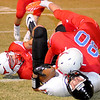 Chisholm's Colton Johnson (80) and Bailey Cross (12) tackle Tonkawa's Owen Simpson (22) during the Longhorns' 33-8 win at Chisholm Friday, Nov. 8, 2013. The Chisholm Longhorns finish the season 9-1. (Staff Photo by BONNIE VCULEK)