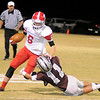 Ringwood's Cole Swart stiff arms Garber's Dallas Hunt during the Wolverines' 28-18 win over the Red Devils at Warren Dell Stadium Friday, Nov. 1, 2013. (Staff Photo by BONNIE VCULEK)