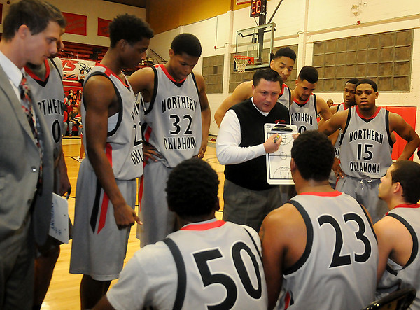 NOC Jets' head basketball coach, Greg Shamburg, discusses a play during the Jets' 126-50 win over the Bacone JV Warriors at the Mabee Center Wednesday, Nov. 13, 2013. (Staff Photo by BONNIE VCULEK)