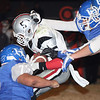 Oklahoma Bible Academy's Kristian Stitt (5) plows for a few yards Friday night in Hooker. The Trojans downed the Hooker Bulldogs 6-0. (Photo by Shawn Yorks/The Guymon Daily Herald)